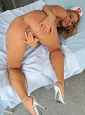 Nurse Nikky Thorne inserts a speculum and dildoing