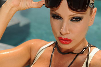 Hot Sandy is masturbating by the swimming pool