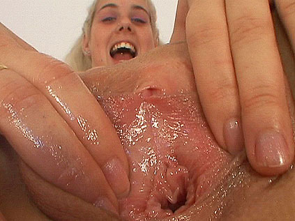 Busty blonde Aletta dildoing and toying a speculum
