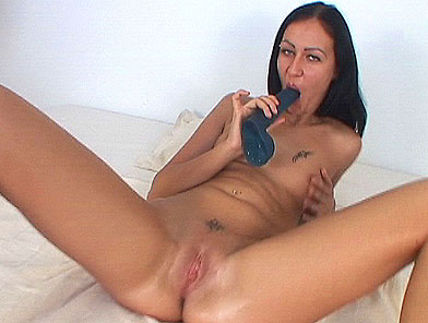 Blackhaired babe playing with speculum and toying