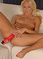 Nasty girl Sophie Moone playing with a red dildo