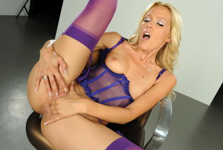 Blonde pornstar Sophie fingerin in purple lingerie