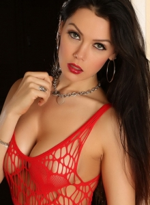 Alluring Vixens: Sultry Alluring Vixen babe Erika G teases in a very skimpy red net dress that leaves little to the imagination