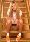 Teenage blonde toying her tight pussyhole on the stairs