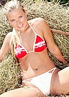 Teenage blonde toying her wet pussy in a haystack with a toy
