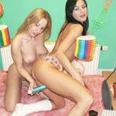 Three lesbian teenage webcamgirls in action with their toys