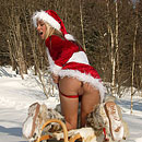 Teenage blonde Xmas girl toying her pussy in the cold snow