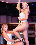 Two big titted British blondes double fucked in a stripclub