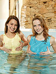 Two teenage girlies toying eachother in a swimming pool