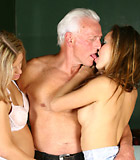 Horny grey senior enjoys two sweet babes their pussies