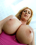 Blonde sexy babe gets fucked between her big round juggies
