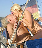 Two horny seniors fucking a blonde hottie on their boat