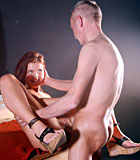 Stunning redhead beauty gets fucked by a horny senior man