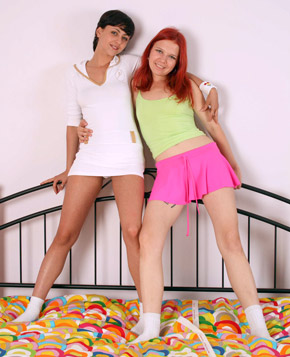 Cute redhead and a dirty brunette using their big strapon