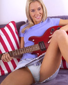 Guitar playing teen blonde showing her pink and tight pussy