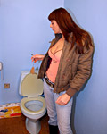 Horny brunette teenie sucking a cock on a public toilet