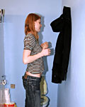 Redhead girl enjoys a big surprise erection trough the wall