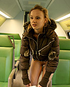 Blonde teenie flashing her body in the public transport