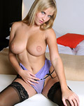 Blonde with big natural knockers showing her sensual body
