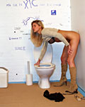 Blonde honey gets a big toilet surprise trough the wall