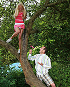 Cute teenage blondie gets boinked while climbing a tree