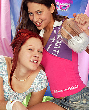 Two lesbian teenagers love using their big toys at home