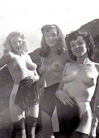 Several sixties beach babes posing naked on a public beach