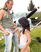 Naughty teen cutie riding a stiff cock near an airplane