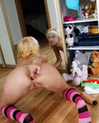 Teenage blonde stuffs both her tight holes at the same time