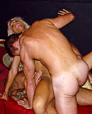 Blonde milf hooker gets dirty with two big erected cocks