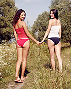 Two young and petite teen girlfriends going naked outdoor