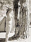 Vintage nudist going fully naked on the natural camping