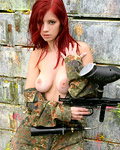 Big breasted paintballing redhead goes fully naked outdoor