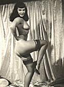 Betty Page with sexy stockings showing her sensual body