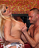 Heavy blonde hooker with big tits jerking an Italian cock