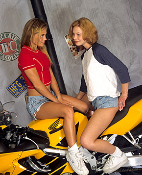Two lesbian blondes enjoy getting dirty after a bike ride