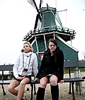 Two Dutch teenagers showing their body in front of windmill