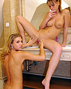 Two cute and horny babes sharing a sensual bathtub together