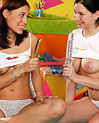 Two cute and horny lesbians playing with a big golden dildo