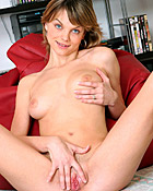 A very horny girl masturbates her wet pussy in the chair