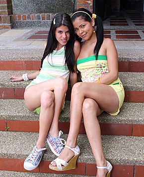 Two hot and horny chicks fondling eachother on the stairs