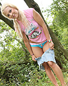 Blonde sweetie undressing outside in the bushes pictures