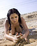 Hot busty teenage cutie playing on the beach alone pictures