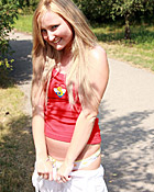 Sexy and daring teenager loves undressing outside on a road
