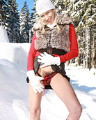 Horny teenager plays with her wet pussy in the cold snow