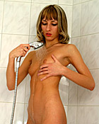 Sweetie playing with a showerhead on her very damp clit