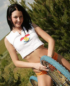 Hot unblemished teenage cutie on a bike plays with a big toy