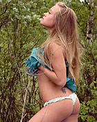 Daring teenage chick masturbating in the forest with a toy