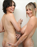 Two hot busty lesbian cuties love playing with baby oil