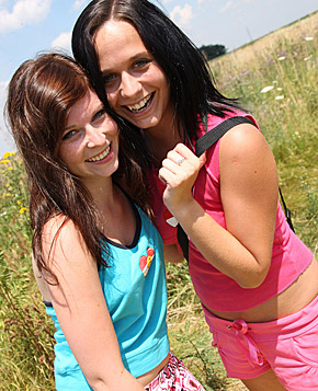 Two sexy girls love fondling eachother outdoors with a toy